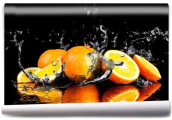 Fototapeta - Orange fruits and Splashing water