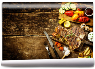 Fototapeta - Preparing t-bone steak and roast vegetables