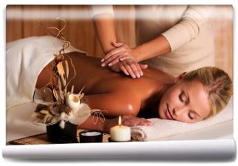 Fototapeta - professional masseur doing massage of female back