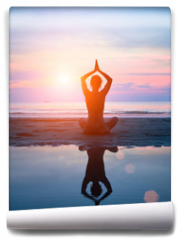 Fototapeta - Silhouette of a woman yoga on sea sunset with reflection.