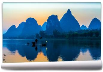 Fototapeta - Silhouette of Fisherman with Cormorant Bird on Boat China River