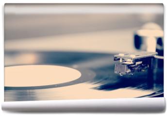 Fototapeta - Spinning vinyl record. Motion blur image.  Vintage toned.