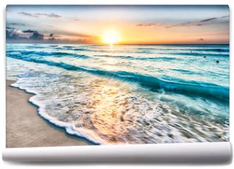 Fototapeta - Sunrise over beach in Cancun