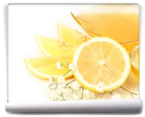 Fototapeta - Sweet honey with lemon isolated on white