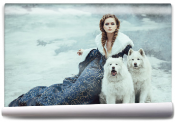 Fototapeta - The woman on winter walk with a dog