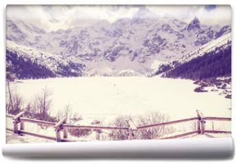 Fototapeta - Vintage stylized frozen lake Morskie Oko in Tatra Mountains, most popular mountain lake in Poland.