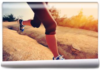 Fototapeta - woman runner athlete running at mountain trail