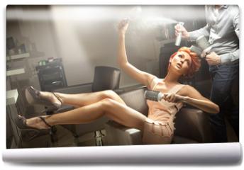 Fototapeta - Young woman posing in hairdresser room