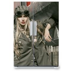 Naklejka na lodówkę - beautiful girl in military uniform with military equipment