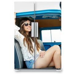 Naklejka na lodówkę - smiling young hippie woman in minivan car