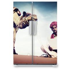 Naklejka na lodówkę - Indian Man Using Laptop Desert Concept