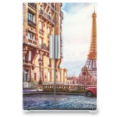 Naklejka na lodówkę - The eifel tower in Paris from a tiny street