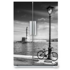 Naklejka na lodówkę - Bicycle under street light on coastline Crete Greece Europe