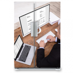 Naklejka na lodówkę - Smiling Businessman Checking Invoice On Computer