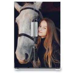 Naklejka na lodówkę - Girl with a horse. Woman in a ranch. Blonde in a black sweater