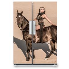 Naklejka na lodówkę - Arabian horse, a girl, and the desert