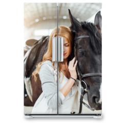 Naklejka na lodówkę - girl with a horse on the racetrack