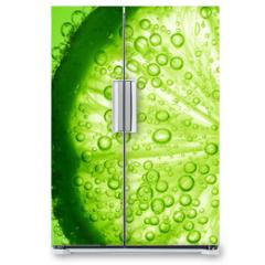 Naklejka na lodówkę - lime slice in water