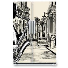 Naklejka na lodówkę - saxophonist in a street of Cuba