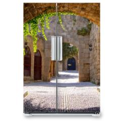 Naklejka na lodówkę - Medieval arched street in the old town of Rhodes, Greece