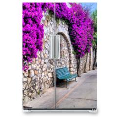 Naklejka na lodówkę - Vibrant flower draped pathway in Capri, Italy