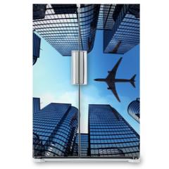 Naklejka na lodówkę - Business towers with a airplane silhouette