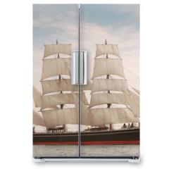 Naklejka na lodówkę - Vintage windjammer style ship with full sails on the open sea