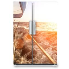 Naklejka na lodówkę - Sailing yacht against sunset. Luxury yachts.