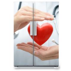 Naklejka na lodówkę - Doctor holding heart