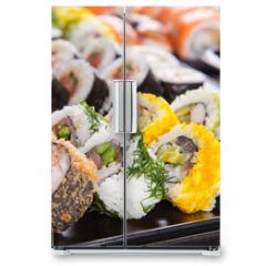 Naklejka na lodówkę - Delicious sushi pieces served on black stone