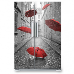 Naklejka na lodówkę - Red umbrellas flying on the street. Conceptual image