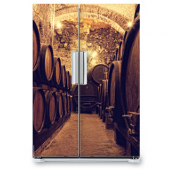 Naklejka na lodówkę -  Wooden barrels with wine in a wine vault, Italy