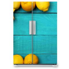 Naklejka na lodówkę - Lemons on the bright cyan background