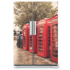 Naklejka na lodówkę - Vintage style  red telephone booths on rainy street in London