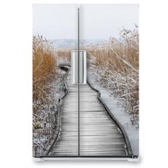 Naklejka na lodówkę - Boardwalk with frozen reeds