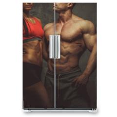 Naklejka na lodówkę - Woman and man bodybuilders posing in studio