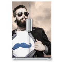 Naklejka na lodówkę - young hipster superhero under a dark sky