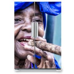 Naklejka na lodówkę - Portrait of african cuban woman smoking cigar in Havana, Cuba