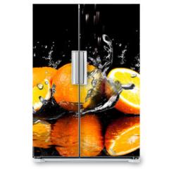 Naklejka na lodówkę - Orange fruits and Splashing water