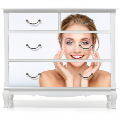Naklejka na meble - Young woman touching her face isolated on white background