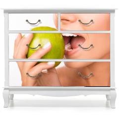 Naklejka na meble - Closeup photo of a beautiful healthy girl biting an apple