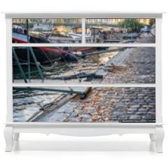 Naklejka na meble - Houseboats on a paved bank of the river Seine, Paris France