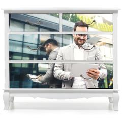 Naklejka na meble - Businessman using tablet