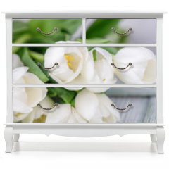 Naklejka na meble - Beautiful white tulips on a light wooden background. Free space