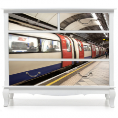 Naklejka na meble - The tube arrives at the station - London subway