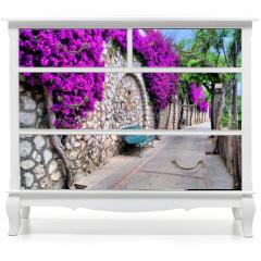 Naklejka na meble - Vibrant flower draped pathway in Capri, Italy