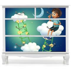 Naklejka na meble - A boy sitting at the cloud