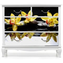 Naklejka na meble - still life with three orchid on pebble