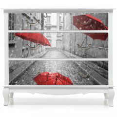 Naklejka na meble - Red umbrellas flying on the street. Conceptual image