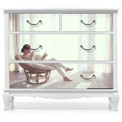 Naklejka na meble - Woman relaxing in chair